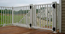 White Encore Walkway Gate Installed On Decking