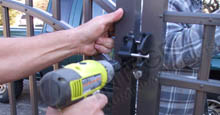 Aluminum Gate Latch Being Installed