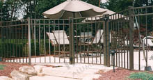 Landing Outside of Swimming Pool Area Showing Aluminum Pool Gate and Fence