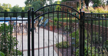 Sanibel Black Metal Pool Fence Panels and Gate With Flattened Finials