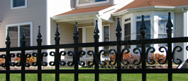 Castile Commercial Fence With Decorative Butterfly Scrolls and Finials