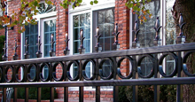 Providence Aluminum Industrial Fencing With Historic Fleur de Lis Finials and Decorative Circles